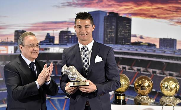 Real Madrids Forward Portuguese Cristiano Ronaldo R Receives A Trophy Fom His Clubs President