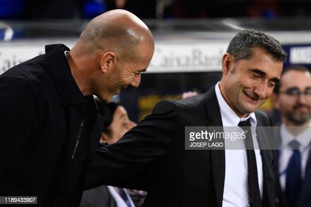 Real Madrid's French coach Zinedine Zidane and Barcelona's Spanish coach Ernesto Valverde shake hands prior to the El Clasico Spanish League football...