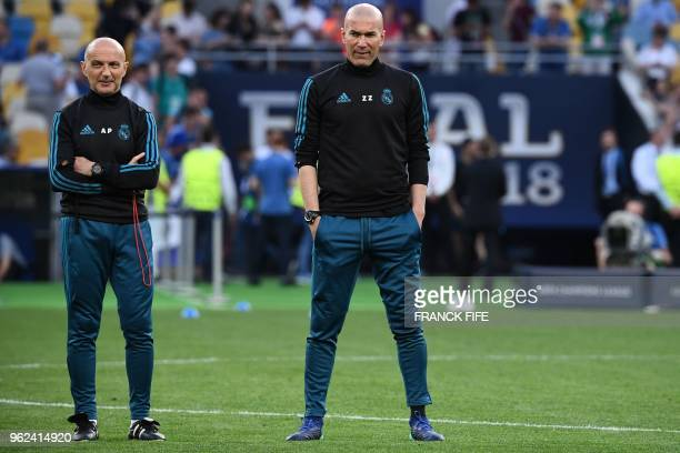 Real Madrid's French coach Zinedine Zidane and fitness coach Antonio Pintus attend a Real Madrid team training session at the Olympic Stadium in Kiev...