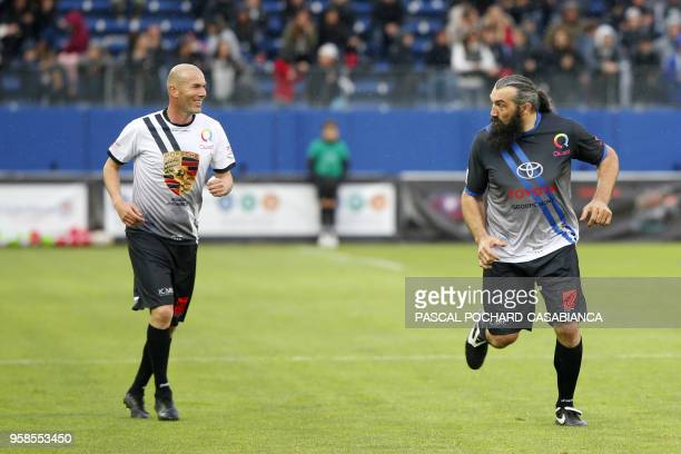 TOPSHOT Real Madrid's French coach Zinedine Zidane and Former French rugby international Sebastien Chabal take part in the charity match organized by...