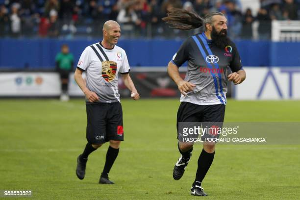Real Madrid's French coach Zinedine Zidane and Former French rugby international Sebastien Chabal take part in the charity match organized by French...