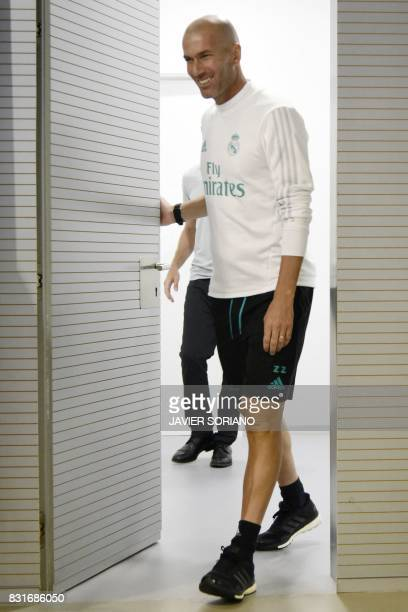 Real Madrid's French coach Zinedine Zidane arrives to give a press coference at Real Madrid sports city in Madrid on August 15 on the eve of the...