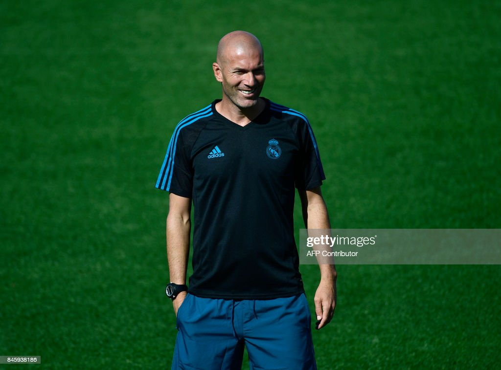 Real Madrid's French coach Zinedine Zidane attends a training session at the Valdebebas Sport City, in Madrid, on September 12, 2017 on the eve of the UEFA Champions League Group H football match Real Madrid CF vs Apoel FC. MARCOU