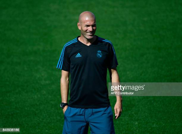 Real Madrid's French coach Zinedine Zidane attends a training session at the Valdebebas Sport City in Madrid on September 12 2017 on the eve of the...