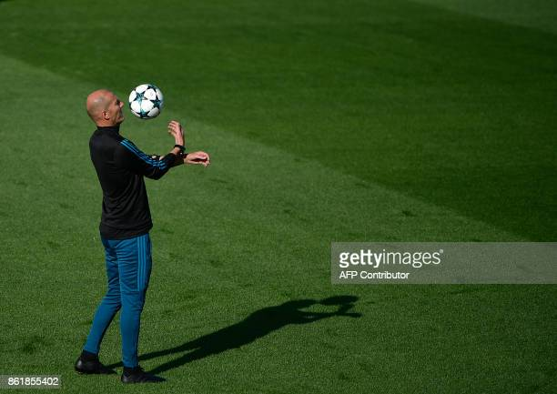 Real Madrid's French coach Zinedine Zidane attends a training session at Valdebebas Sport City in Madrid on October 16 2017 on the eve of a...