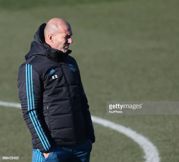 Real Madrid's French coach Zinedine Zidane attends a training session at Valdebebas Sport City in Madrid on December 5 2017 on the eve of their...