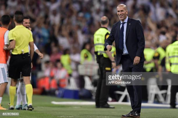 Real Madrid's French coach Zinedine Zidane celebrates their opener during the second leg of the Spanish Supercup football match Real Madrid vs FC...