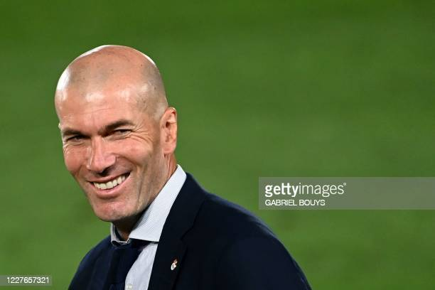 Real Madrid's French coach Zinedine Zidane celebrates winning the Liga title after the Spanish League football match between Real Madrid CF and...