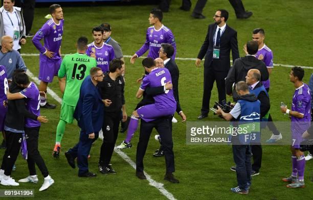 Real Madrid's French coach Zinedine Zidane celebrates with Real Madrid's Spanish defender Nacho Fernandez after winning the UEFA Champions League...