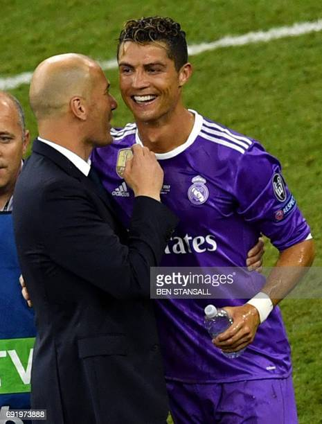Real Madrid's French coach Zinedine Zidane celebrates with Real Madrid's Portuguese striker Cristiano Ronaldo after winning the UEFA Champions League...