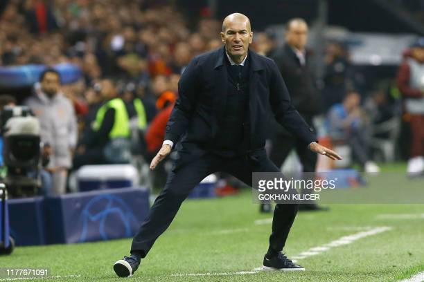 TOPSHOT Real Madrid's French coach Zinedine Zidane gestures during the UEFA Champions League group A football match between Galatasaray and Real...