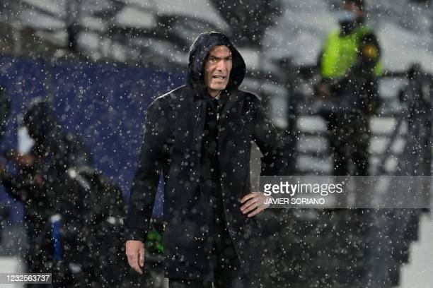 Real Madrid's French coach Zinedine Zidane gestures during the UEFA Champions League semi-final first leg football match between Real Madrid and...