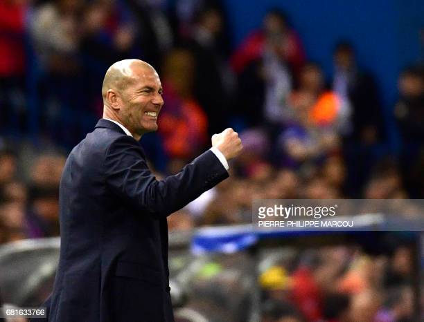 TOPSHOT Real Madrid's French coach Zinedine Zidane gestures on the sideline during the UEFA Champions League semi final second leg football match...