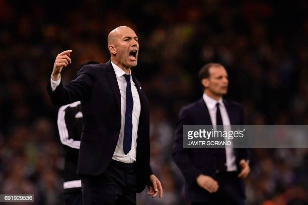 Real Madrid's French coach Zinedine Zidane gestures on the touchline during the UEFA Champions League final football match between Juventus and Real...