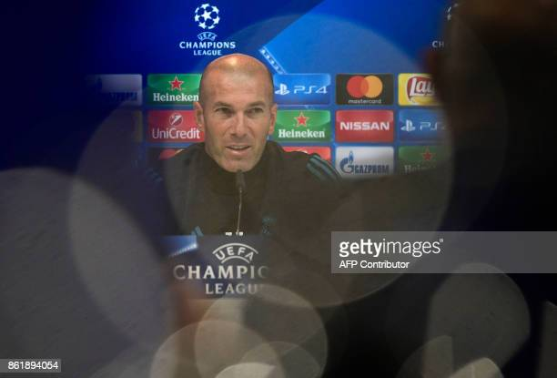 TOPSHOT Real Madrid's French coach Zinedine Zidane gives a press conference after a training session at Valdebebas Sport City in Madrid on October 16...
