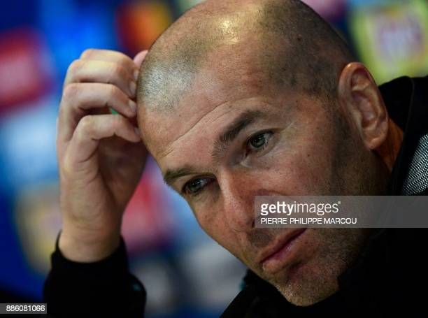 Real Madrid's French coach Zinedine Zidane gives a press conference following a training session at Valdebebas Sport City in Madrid on December 5...