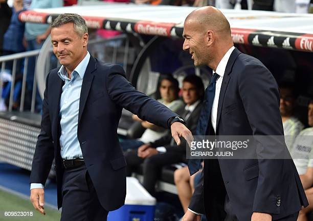 Real Madrid's French coach Zinedine Zidane greets Villarreal's coach Fran Escriba before the Spanish league football match Real Madrid CF vs...