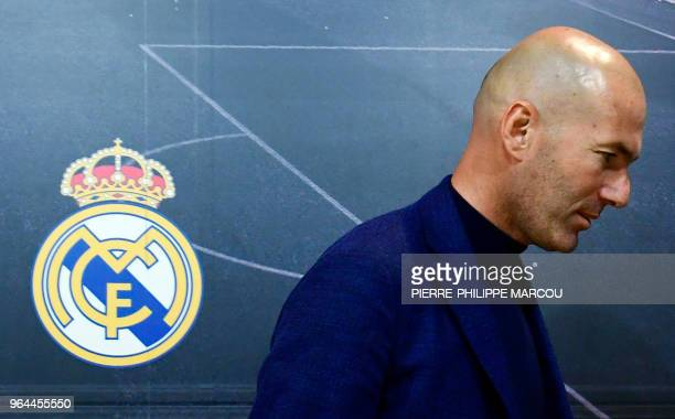 TOPSHOT Real Madrid's French coach Zinedine Zidane leaves after announcing his resignation in Madrid on May 31 2018 Real Madrid coach Zinedine Zidane...
