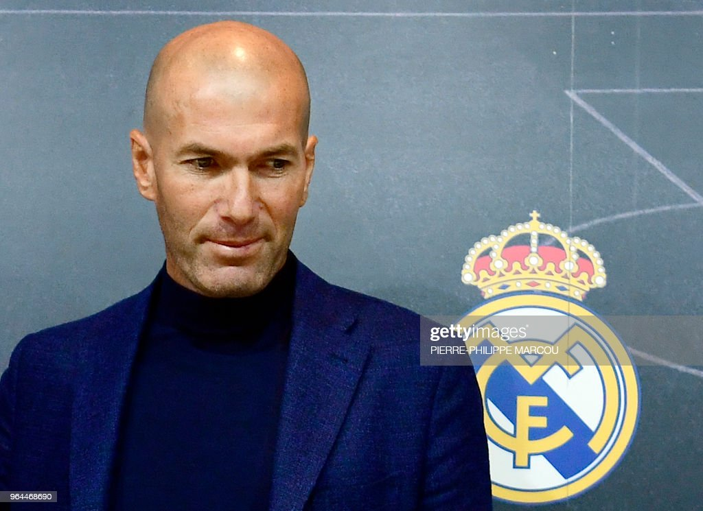 TOPSHOT - Real Madrid's French coach Zinedine Zidane looks on after a press conference to announce his resignation in Madrid on May 31, 2018. - Real Madrid coach Zinedine Zidane said today he was leaving the Spanish giants, just days after winning the Champions League for the third year in a row.