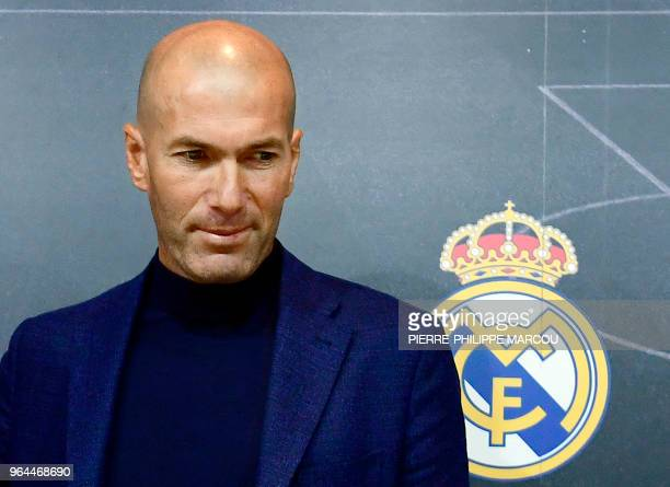 Real Madrid's French coach Zinedine Zidane looks on after a press conference to announce his resignation in Madrid on May 31, 2018. - Real Madrid...