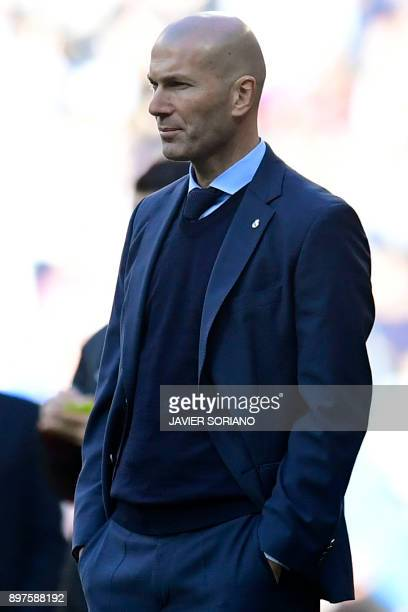 Real Madrid's French coach Zinedine Zidane looks on during the Spanish League 'Clasico' football match Real Madrid CF vs FC Barcelona at the Santiago...