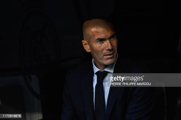 TOPSHOT Real Madrid's French coach Zinedine Zidane looks on prior to the UEFA Champions league Group A football match between Real Madrid and Club...