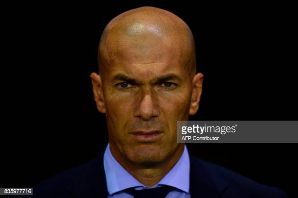 Real Madrid's French coach Zinedine Zidane observes a minute of silence in tribute to the victims of Barcelona and Cambrils attacks before the...