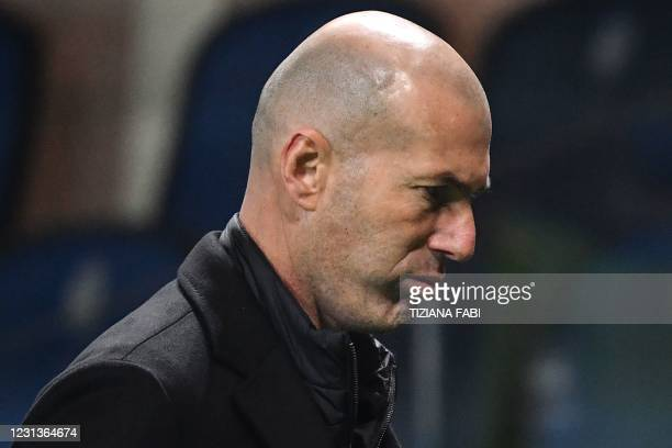 Real Madrid's French coach Zinedine Zidane reacts as he meaves the pitch at the end of the UEFA Champions League round of 16 first leg football match...