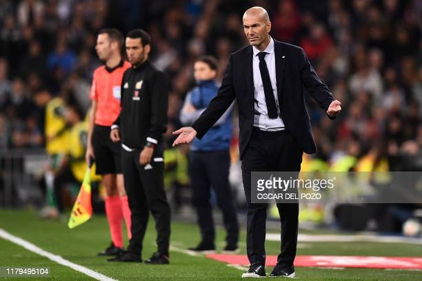 Real Madrid's French coach Zinedine Zidane reacts during the Spanish League football match between Real Madrid CF and Real Betis at the Santiago...
