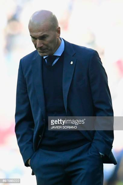 Real Madrid's French coach Zinedine Zidane reacts during the Spanish League 'Clasico' football match Real Madrid CF vs FC Barcelona at the Santiago...