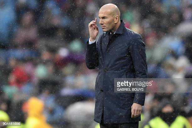 Real Madrid's French coach Zinedine Zidane reacts during the Spanish league football match between Real Madrid and Villarreal at the Santiago...