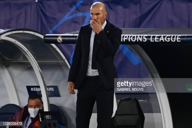 Real Madrid's French coach Zinedine Zidane reacts during the UEFA Champions League group B football match between Real Madrid and Shakhtar Donetsk at...