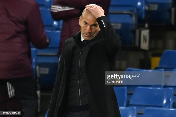 Real Madrid's French coach Zinedine Zidane reacts during the UEFA Champions League second leg semi-final football match between Chelsea and Real...