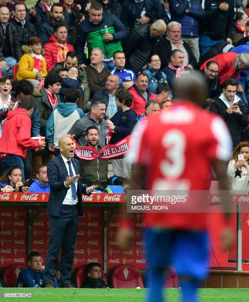 Real Madrid's French coach Zinedine Zidane shouts after the second goal scored by Sporting Gijon's midfielder Mikel Vesga during the Spanish league...