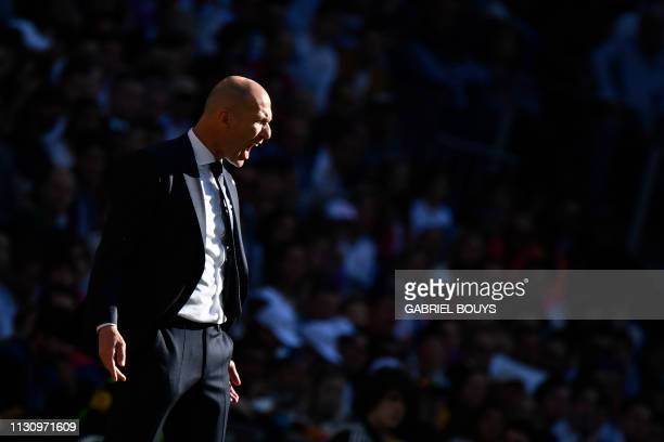 TOPSHOT Real Madrid's French coach Zinedine Zidane shouts from the sideline during the Spanish league football match between Real Madrid CF and RC...