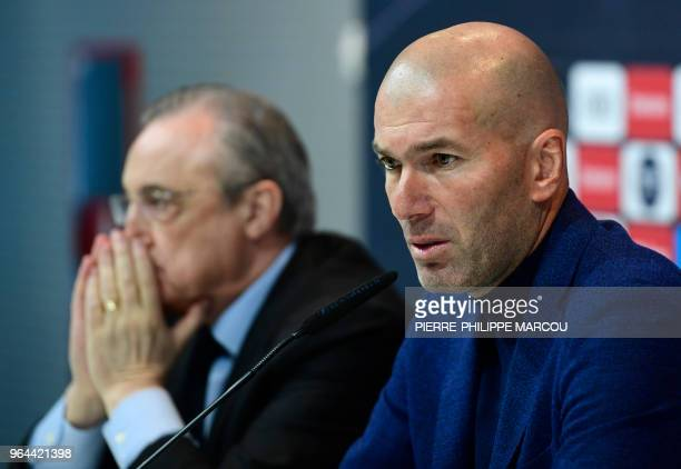 Real Madrid's French coach Zinedine Zidane sits beside president Florentino Perez, during a press conference to announce his resignation in Madrid on...