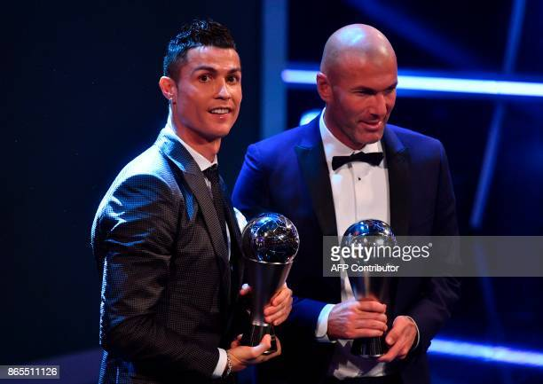 Real Madrid's French coach Zinedine Zidane stands with his trophy for winning The Best FIFA Men's Coach of 2017 Award alongside Real Madrid and...