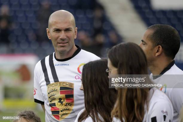 Real Madrid's French coach Zinedine Zidane waits before the start of the charity match organized by French football player Pascal Olmeta for his...