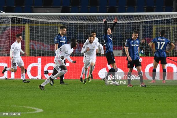 Real Madrid's French defender Ferland Mendy celebrates after opening the scoring during the UEFA Champions League round of 16 first leg football...