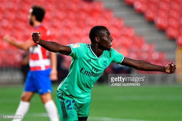 Real Madrid's French defender Ferland Mendy celebrates after scoring during the Spanish league football match Granada FC vs Real Madrid CF at Nuevo...