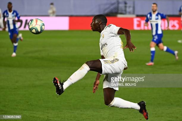 Real Madrid's French defender Ferland Mendy controls the ball during the Spanish League football match between Real Madrid and Alaves at the Alfredo...