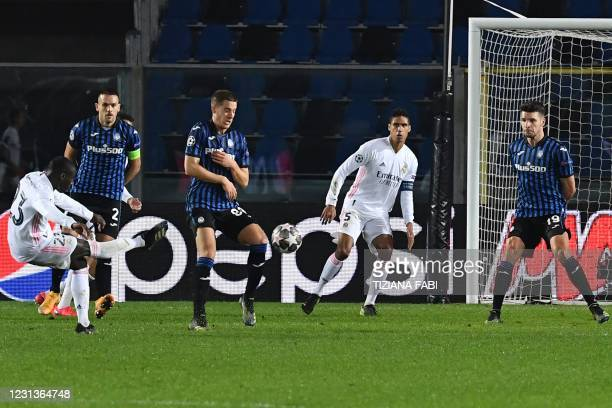 Real Madrid's French defender Ferland Mendy shoots to open the scoring during the UEFA Champions League round of 16 first leg football match Atalanta...