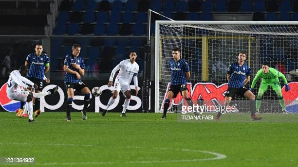 Real Madrid's French defender Ferland Mendy shoots to openthe scoring during the UEFA Champions League round of 16 first leg football match Atalanta...