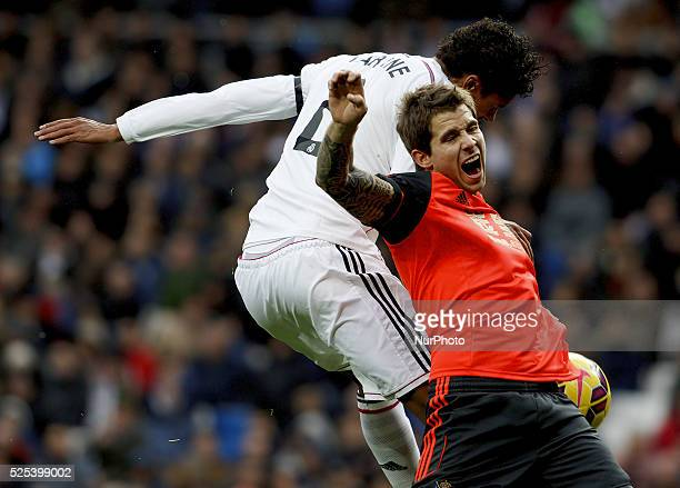 Real Madrid's French Defender Rafael Varane and Real Sociedads Spanish Defender I��igo Martinez during the Spanish League 2014/15 match between Real...