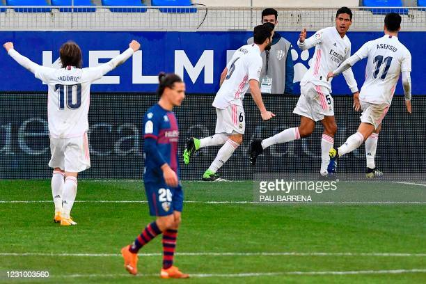 Real Madrid's French defender Raphael Varane celebrates with teammates after scoring a second goal during the Spanish league football match between...