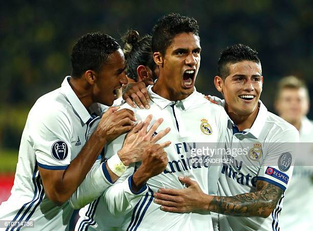 TOPSHOT Real Madrid's French defender Raphael Varane reacts after scoring during the UEFA Champions League first leg football match between Borussia...