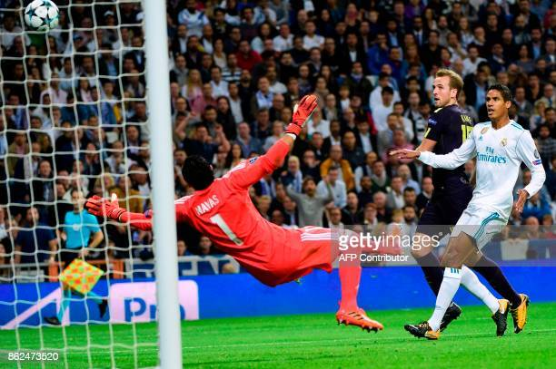 Real Madrid's French defender Raphael Varane scores an own goal during the UEFA Champions League group H football match Real Madrid CF vs Tottenham...