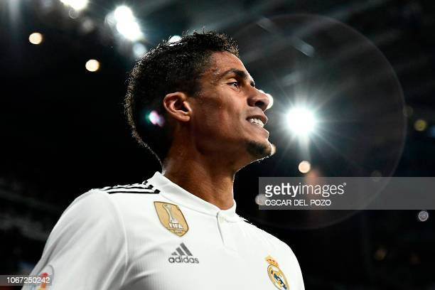 Real Madrid's French defender Raphael Varane smiles during the Spanish league football match between Real Madrid and Valencia at the Santiago...