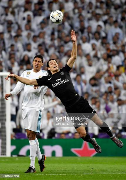 Real Madrid's French defender Raphael Varane vies with Paris SaintGermain's Uruguayan forward Edinson Cavani during the UEFA Champions League round...