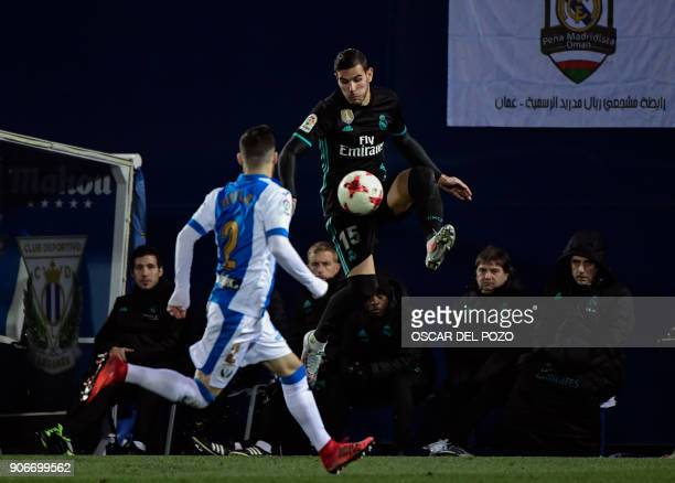 Real Madrid's French defender Theo Hernandez challenges Leganes' Spanish defender Tito during the Spanish 'Copa del Rey' football match between...